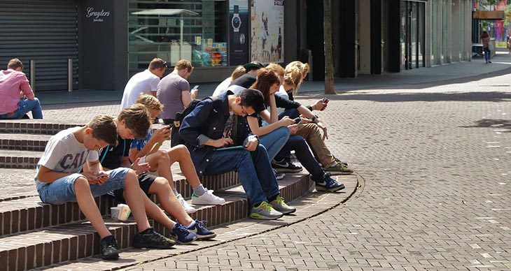 picture of a group of kids on digital devices to accompany article about Gaggle online student privacy